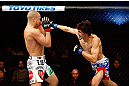 MONTREAL, QC - NOVEMBER 17:  Pablo Garza (R) throws a punch against Mark Hominick in their featherweight bout during UFC 154 on November 17, 2012  at the Bell Centre in Montreal, Canada.  (Photo by Josh Hedges/Zuffa LLC/Zuffa LLC via Getty Images)