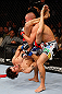 MONTREAL, QC - NOVEMBER 17:  Pablo Garza (L) grapples against Mark Hominick in their featherweight bout during UFC 154 on November 17, 2012  at the Bell Centre in Montreal, Canada.  (Photo by Josh Hedges/Zuffa LLC/Zuffa LLC via Getty Images)