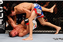 MONTREAL, QC - NOVEMBER 17:  Pablo Garza (R) grapples against Mark Hominick in their featherweight bout during UFC 154 on November 17, 2012  at the Bell Centre in Montreal, Canada.  (Photo by Josh Hedges/Zuffa LLC/Zuffa LLC via Getty Images)