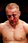 MONTREAL, QC - NOVEMBER 17:  A cut and bloodied Mark Hominick looks on while fight against Pablo Garza during their featherweight bout during UFC 154 on November 17, 2012  at the Bell Centre in Montreal, Canada.  (Photo by Josh Hedges/Zuffa LLC/Zuffa LLC via Getty Images)