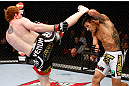 MONTREAL, QC - NOVEMBER 17:  Rafael dos Anjos (R)  blocks a kick from Mark Bocek in their lightweight bout during UFC 154 on November 17, 2012  at the Bell Centre in Montreal, Canada.  (Photo by Josh Hedges/Zuffa LLC/Zuffa LLC via Getty Images)