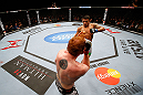 MONTREAL, QC - NOVEMBER 17:  Rafael dos Anjos attempts to land a kick against Mark Bocek in their lightweight bout during UFC 154 on November 17, 2012  at the Bell Centre in Montreal, Canada.  (Photo by Josh Hedges/Zuffa LLC/Zuffa LLC via Getty Images)