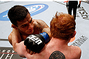 MONTREAL, QC - NOVEMBER 17:  Rafael dos Anjos (L) fights against Mark Bocek in their lightweight bout during UFC 154 on November 17, 2012  at the Bell Centre in Montreal, Canada.  (Photo by Josh Hedges/Zuffa LLC/Zuffa LLC via Getty Images)