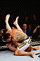 MONTREAL, QC - NOVEMBER 17:  Rafael dos Anjos (R) grapples against Mark Bocek in their lightweight bout during UFC 154 on November 17, 2012  at the Bell Centre in Montreal, Canada.  (Photo by Josh Hedges/Zuffa LLC/Zuffa LLC via Getty Images)