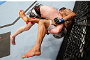 MONTREAL, QC - NOVEMBER 17:  Rafael dos Anjos gets taken down by Mark Bocek (L) during their lightweight bout during UFC 154 on November 17, 2012  at the Bell Centre in Montreal, Canada.  (Photo by Josh Hedges/Zuffa LLC/Zuffa LLC via Getty Images)