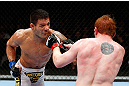 MONTREAL, QC - NOVEMBER 17:  Rafael dos Anjos (L) throws a punch against Mark Bocek in their lightweight bout during UFC 154 on November 17, 2012  at the Bell Centre in Montreal, Canada.  (Photo by Josh Hedges/Zuffa LLC/Zuffa LLC via Getty Images)