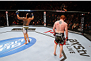 MONTREAL, QC - NOVEMBER 17:  Rafael dos Anjos (L) reacts after fighting against Mark Bocek in their lightweight bout during UFC 154 on November 17, 2012  at the Bell Centre in Montreal, Canada.  (Photo by Josh Hedges/Zuffa LLC/Zuffa LLC via Getty Images)