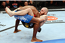 MONTREAL, QC - NOVEMBER 17:  Tom Lawlor (R) grapples against Francis Carmont in their middleweight bout during UFC 154 on November 17, 2012  at the Bell Centre in Montreal, Canada.  (Photo by Josh Hedges/Zuffa LLC/Zuffa LLC via Getty Images)