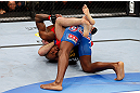MONTREAL, QC - NOVEMBER 17:  Tom Lawlor (L) grapples against Francis Carmont during their middleweight bout during UFC 154 on November 17, 2012  at the Bell Centre in Montreal, Canada.  (Photo by Josh Hedges/Zuffa LLC/Zuffa LLC via Getty Images)
