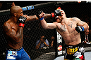MONTREAL, QC - NOVEMBER 17:  Tom Lawlor (R) fights against Francis Carmont in their middleweight bout during UFC 154 on November 17, 2012  at the Bell Centre in Montreal, Canada.  (Photo by Josh Hedges/Zuffa LLC/Zuffa LLC via Getty Images)