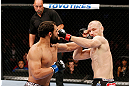 MONTREAL, QC - NOVEMBER 17:  Johny Hendricks (L) knocks out Martin Kampmann with a left in the first round to win their welterweight bout during UFC 154 on November 17, 2012  at the Bell Centre in Montreal, Canada.  (Photo by Josh Hedges/Zuffa LLC/Zuffa LLC via Getty Images)