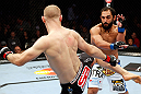 MONTREAL, QC - NOVEMBER 17:  Johny Hendricks (R) fights against Martin Kampmann in their welterweight bout during UFC 154 on November 17, 2012  at the Bell Centre in Montreal, Canada.  (Photo by Josh Hedges/Zuffa LLC/Zuffa LLC via Getty Images)