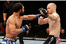 MONTREAL, QC - NOVEMBER 17:  Johny Hendricks (L) knocks out Martin Kampmann with a left hook in the first round to win their welterweight bout during UFC 154 on November 17, 2012  at the Bell Centre in Montreal, Canada.  (Photo by Josh Hedges/Zuffa LLC/Zuffa LLC via Getty Images)