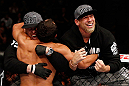 MONTREAL, QC - NOVEMBER 17:  Johny Hendricks celebrates with his corner after knocking out Martin Kampmann with a left in the first round to win their welterweight bout during UFC 154 on November 17, 2012  at the Bell Centre in Montreal, Canada.  (Photo by Josh Hedges/Zuffa LLC/Zuffa LLC via Getty Images)