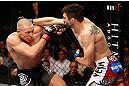 MONTREAL, QC - NOVEMBER 17:  Carlos Condit (R) thorws a punch against Georges St-Pierre in their welterweight title bout during UFC 154 on November 17, 2012  at the Bell Centre in Montreal, Canada.  (Photo by Josh Hedges/Zuffa LLC/Zuffa LLC via Getty Images)