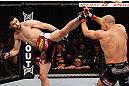 MONTREAL, QC - NOVEMBER 17:  Georges St-Pierre  blocks the kick of Carlos Condit in their welterweight title bout during UFC 154 on November 17, 2012  at the Bell Centre in Montreal, Canada.  (Photo by Josh Hedges/Zuffa LLC/Zuffa LLC via Getty Images)