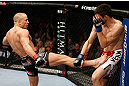 MONTREAL, QC - NOVEMBER 17:  Georges St-Pierre (L) throws a kick against Carlos Condit in their welterweight title bout during UFC 154 on November 17, 2012  at the Bell Centre in Montreal, Canada.  (Photo by Josh Hedges/Zuffa LLC/Zuffa LLC via Getty Images)