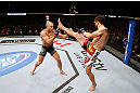 MONTREAL, QC - NOVEMBER 17:  Carlos Condit (R) attempts a kick against Georges St-Pierre in their welterweight title bout during UFC 154 on November 17, 2012  at the Bell Centre in Montreal, Canada.  (Photo by Josh Hedges/Zuffa LLC/Zuffa LLC via Getty Images)
