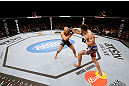 MONTREAL, QC - NOVEMBER 17:  Carlos Condit (R) lands a punch against Georges St-Pierre in their welterweight title bout during UFC 154 on November 17, 2012  at the Bell Centre in Montreal, Canada.  (Photo by Josh Hedges/Zuffa LLC/Zuffa LLC via Getty Images)