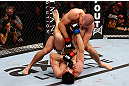 MONTREAL, QC - NOVEMBER 17:  Carlos Condit (bottom) grapples against Georges St-Pierre in their welterweight title bout during UFC 154 on November 17, 2012  at the Bell Centre in Montreal, Canada.  (Photo by Josh Hedges/Zuffa LLC/Zuffa LLC via Getty Images)