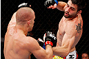 MONTREAL, QC - NOVEMBER 17:  Carlos Condit (L) fights against Georges St-Pierre in their welterweight title bout during UFC 154 on November 17, 2012  at the Bell Centre in Montreal, Canada.  (Photo by Josh Hedges/Zuffa LLC/Zuffa LLC via Getty Images)