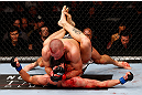 MONTREAL, QC - NOVEMBER 17:  Georges St-Pierre (top) grapples against Carlos Condit in their welterweight title bout during UFC 154 on November 17, 2012  at the Bell Centre in Montreal, Canada.  (Photo by Josh Hedges/Zuffa LLC/Zuffa LLC via Getty Images)