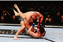 MONTREAL, QC - NOVEMBER 17:  Georges St-Pierre throws a punch to the face of Carlos Condit in their welterweight title bout during UFC 154 on November 17, 2012  at the Bell Centre in Montreal, Canada.  (Photo by Josh Hedges/Zuffa LLC/Zuffa LLC via Getty Images)