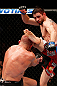MONTREAL, QC - NOVEMBER 17:  Carlos Condit lands a left footed kick to the head of Georges St-Pierre in their welterweight title bout during UFC 154 on November 17, 2012  at the Bell Centre in Montreal, Canada.  (Photo by Josh Hedges/Zuffa LLC/Zuffa LLC via Getty Images)