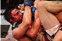 MONTREAL, QC - NOVEMBER 17:  Carlos Condit (L) grapples against Georges St-Pierre in their welterweight title bout during UFC 154 on November 17, 2012  at the Bell Centre in Montreal, Canada.  (Photo by Josh Hedges/Zuffa LLC/Zuffa LLC via Getty Images)