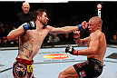 MONTREAL, QC - NOVEMBER 17:  Carlos Condit (L) lands a punch against Georges St-Pierre in their welterweight title bout during UFC 154 on November 17, 2012  at the Bell Centre in Montreal, Canada.  (Photo by Josh Hedges/Zuffa LLC/Zuffa LLC via Getty Images)
