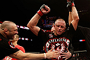 MONTREAL, QC - NOVEMBER 17:  Georges St-Pierre reacts after defeating Carlos Condit by a unanimous decision to retain his welterweight title during UFC 154 on November 17, 2012  at the Bell Centre in Montreal, Canada.  (Photo by Josh Hedges/Zuffa LLC/Zuffa LLC via Getty Images)