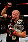 MONTREAL, QC - NOVEMBER 17:  Georges St-Pierre reacts with the belt after defeating Carlos Condit by a unanimous decision to retain his welterweight title during UFC 154 on November 17, 2012  at the Bell Centre in Montreal, Canada.  (Photo by Josh Hedges/Zuffa LLC/Zuffa LLC via Getty Images)