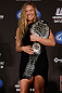 SEATTLE, WA - DECEMBER 06:  Ronda Rousey poses for photos after being presented with the UFC women's bantamweight championship during the UFC on FOX press conference on December 6, 2012 at Key Arena in Seattle, Washington.  (Photo by Josh Hedges/Zuffa LLC/Zuffa LLC via Getty Images)