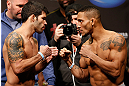 SEATTLE, WA - DECEMBER 07:  (L-R) Opponents Raphael Assuncao and Mike Easton face off during the official UFC on FOX weigh in on December 7, 2012 at Key Arena in Seattle, Washington.  (Photo by Josh Hedges/Zuffa LLC/Zuffa LLC via Getty Images)