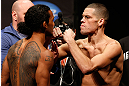 SEATTLE, WA - DECEMBER 07:  (L-R) Opponents Benson Henderson and Nate Diaz face off during the official UFC on FOX weigh in on December 7, 2012 at Key Arena in Seattle, Washington.  (Photo by Josh Hedges/Zuffa LLC/Zuffa LLC via Getty Images)