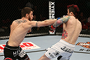 SEATTLE, WA - DECEMBER 08:  (L-R) John Albert punches Scott Jorgensen during their bantamweight bout at the UFC on FOX event on December 8, 2012  at Key Arena in Seattle, Washington.  (Photo by Ezra Shaw/Zuffa LLC/Zuffa LLC via Getty Images) *** Local Caption *** Scott Jorgensen; John Albert