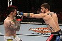 SEATTLE, WA - DECEMBER 08:  (R-L) John Albert punches Scott Jorgensen during their bantamweight bout at the UFC on FOX event on December 8, 2012  at Key Arena in Seattle, Washington.  (Photo by Ezra Shaw/Zuffa LLC/Zuffa LLC via Getty Images) *** Local Caption *** Scott Jorgensen; John Albert