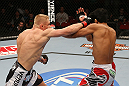 SEATTLE, WA - DECEMBER 08:  (L-R) Dennis Siver punches Nam Phan during their featherweight bout at the UFC on FOX event on December 8, 2012  at Key Arena in Seattle, Washington.  (Photo by Ezra Shaw/Zuffa LLC/Zuffa LLC via Getty Images) *** Local Caption *** Dennis Siver; Nam Phan
