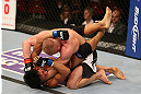 SEATTLE, WA - DECEMBER 08:  Dennis Siver (top) punches Nam Phan (bottom)during their featherweight bout at the UFC on FOX event on December 8, 2012  at Key Arena in Seattle, Washington.  (Photo by Ezra Shaw/Zuffa LLC/Zuffa LLC via Getty Images) *** Local Caption *** Dennis Siver; Nam Phan