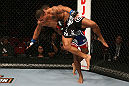 SEATTLE, WA - DECEMBER 08:  Abel Trujillo (black shorts) is lifted by Marcus LeVesseur during their lightweight bout at the UFC on FOX event on December 8, 2012  at Key Arena in Seattle, Washington.  (Photo by Ezra Shaw/Zuffa LLC/Zuffa LLC via Getty Images) *** Local Caption *** Marcus LeVesseur; Abel Trujillo