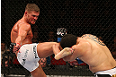 SEATTLE, WA - DECEMBER 08:  (L-R) Daron Cruickshank kicks Henry Martinez  during their lightweight bout at the UFC on FOX event on December 8, 2012  at Key Arena in Seattle, Washington.  (Photo by Ezra Shaw/Zuffa LLC/Zuffa LLC via Getty Images) *** Local Caption *** Daron Cruickshank; Henry Martinez