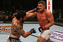 SEATTLE, WA - DECEMBER 08:  (L-R) Henry Martinez punches Daron Cruickshank during their lightweight bout at the UFC on FOX event on December 8, 2012  at Key Arena in Seattle, Washington.  (Photo by Ezra Shaw/Zuffa LLC/Zuffa LLC via Getty Images) *** Local Caption *** Daron Cruickshank; Henry Martinez