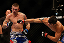 SEATTLE, WA - DECEMBER 08:  (R-L) Ramsey Nijem punches Joe Proctor during their lightweight bout at the UFC on FOX event on December 8, 2012  at Key Arena in Seattle, Washington.  (Photo by Josh Hedges/Zuffa LLC/Zuffa LLC via Getty Images) *** Local Caption *** Ramsey Nijem; Joe Proctor