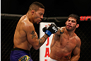 SEATTLE, WA - DECEMBER 08:  (R-L) Raphael Assuncao punches Mike Easton during their bantamweight bout at the UFC on FOX event on December 8, 2012  at Key Arena in Seattle, Washington.  (Photo by Ezra Shaw/Zuffa LLC/Zuffa LLC via Getty Images) *** Local Caption *** Raphael Assuncao; Mike Easton