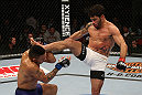 SEATTLE, WA - DECEMBER 08:  (R-L) Raphael Assuncao kicks Mike Easton during their bantamweight bout at the UFC on FOX event on December 8, 2012  at Key Arena in Seattle, Washington.  (Photo by Ezra Shaw/Zuffa LLC/Zuffa LLC via Getty Images) *** Local Caption *** Raphael Assuncao; Mike Easton