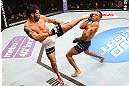 SEATTLE, WA - DECEMBER 08:  (L-R) Raphael Assuncao kicks Mike Easton during their bantamweight bout at the UFC on FOX event on December 8, 2012  at Key Arena in Seattle, Washington.  (Photo by Ezra Shaw/Zuffa LLC/Zuffa LLC via Getty Images) *** Local Caption *** Raphael Assuncao; Mike Easton