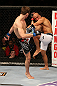 SEATTLE, WA - DECEMBER 08:  (L-R) Rory MacDonald kicks BJ Penn during their welterweight bout at the UFC on FOX event on December 8, 2012  at Key Arena in Seattle, Washington.  (Photo by Ezra Shaw/Zuffa LLC/Zuffa LLC via Getty Images) *** Local Caption *** BJ Penn; Rory MacDonald