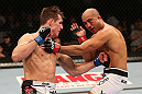 SEATTLE, WA - DECEMBER 08:  (L-R) Rory MacDonald punches BJ Penn during their welterweight bout at the UFC on FOX event on December 8, 2012  at Key Arena in Seattle, Washington.  (Photo by Ezra Shaw/Zuffa LLC/Zuffa LLC via Getty Images) *** Local Caption *** BJ Penn; Rory MacDonald