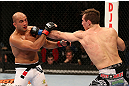 SEATTLE, WA - DECEMBER 08:  (R-L) Rory MacDonald punches BJ Penn during their welterweight bout at the UFC on FOX event on December 8, 2012  at Key Arena in Seattle, Washington.  (Photo by Ezra Shaw/Zuffa LLC/Zuffa LLC via Getty Images) *** Local Caption *** BJ Penn; Rory MacDonald