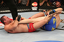 SEATTLE, WA - DECEMBER 08:  (L-R) Mauricio Rua attempts to submit Alexander Gustafsson during their light heavyweight bout at the UFC on FOX event on December 8, 2012  at Key Arena in Seattle, Washington.  (Photo by Ezra Shaw/Zuffa LLC/Zuffa LLC via Getty Images) *** Local Caption *** Mauricio Rua; Alexander Gustafsson